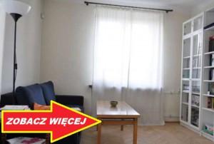 widok na piękny salon w mieszkaniu na sprzedaż