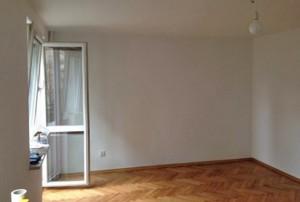 zdjęcie przedstawia mieszkanie na sprzedaż w Śródmieściu Warszawy, widok na duży pokój