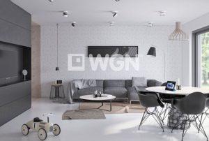 na zdjęciu widoczny jest nowocześnie urządzony salon w mieszkaniu w Warszawie do sprzedaży