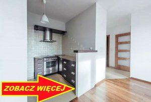 na zdjęciu aneks kuchenny i fragment salonu w mieszkaniu do sprzedaży w Warszawie